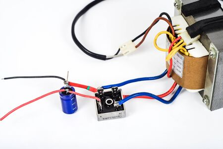Tranfromer AC power to DC power with diode bridge and capacitor . Фото со стока