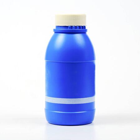 Brake oil in blue bottle on white. Zdjęcie Seryjne