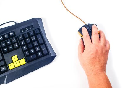 closeup of man hand clicking computer mouse and top view.