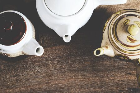 Teapot collection or hot drink on wood table.