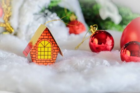 Miniature house for christmas decoration on rustic table,Christmas background.