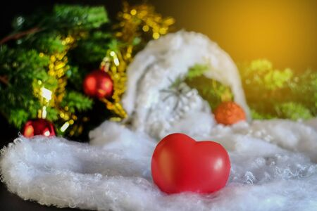 Red heart ball christmas decoration on rustic table,Christmas background. Stockfoto