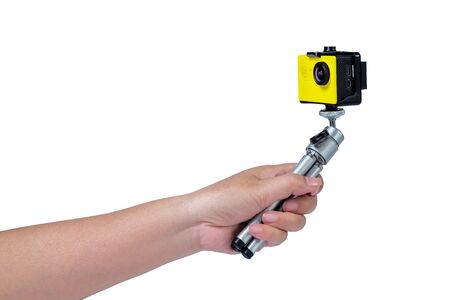 Action camera on mini tripod in hand with white background.