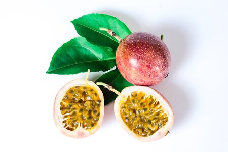 Fresh Passion fruits slice is sour test on white background