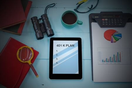 401K Plan text on tablet with cup of coffee, pen and smartphone.