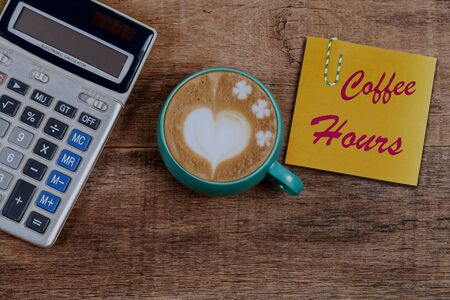 Paper note with good morning text and Hot Coffee Latte Art Heart on color background.
