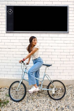 Teen girl with vintage bicycle at out door.
