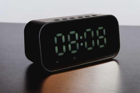 Black Digital alarm clock on background. Foto de archivo