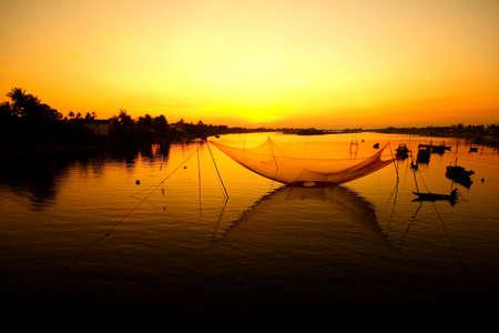 fisherman at sunrise Stock Photo - 7777743