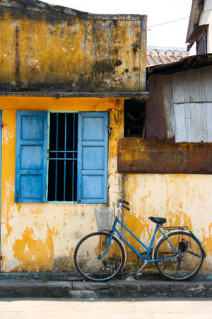 Blue window with bicycle photo
