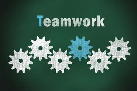 Teamwork words and gear on chalkboard  photo