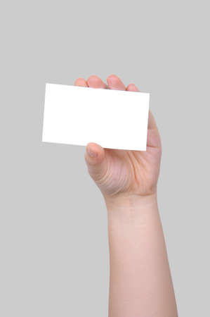 holding business card: hand holding blank card