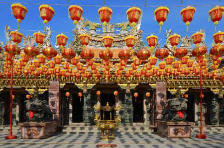 chiness: illuminated chinese lanterns hanging in chiness temple for new year celebrating