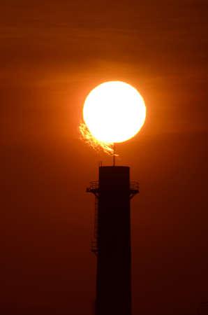 Silhouette oil refinery at sunrise  , super tele