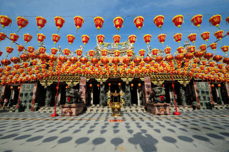 illuminated chinese lanterns hanging in chiness temple for new year celebrating