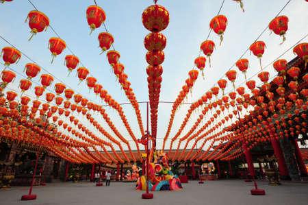 chinese lanterns: illuminated chinese lanterns hanging in street for new year celebrating