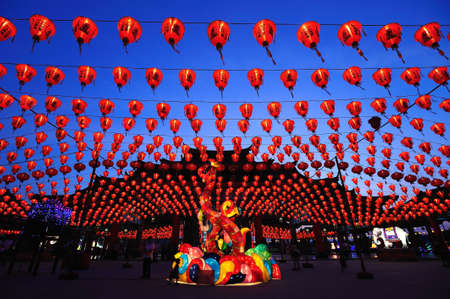 illuminated chinese lanterns hanging in street for new year celebrating