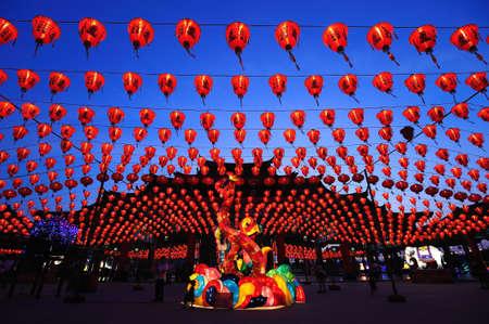 illuminated chinese lanterns hanging in street for new year celebrating