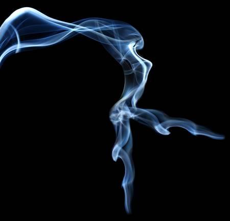 smoke effect: Abstract smoke beautiful shape woman isolated on black