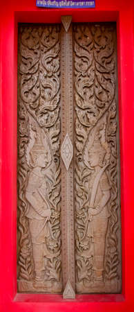 Animal Carvings On The Doors Of The Temple In The Novel In A Thai Temple photo
