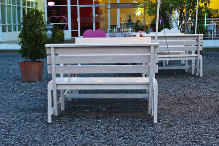 Wood chair in beautiful garden photo
