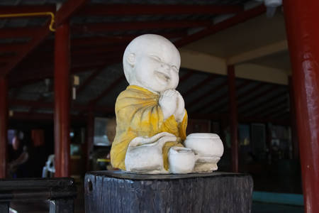 Buddhist novice statue photo