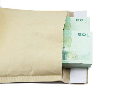 Thai money with paper bag on white background photo
