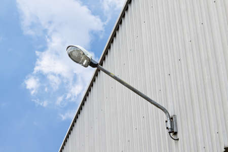 street light against Wall and blue sky background image photo