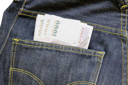 savings problems: 1000 baht bill in jean pocket,Thailand money Stock Photo