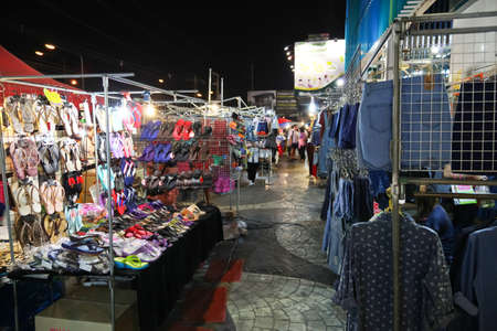 march 17: Chonburi, THAILAND - March 17, 2015:  Tourists stroll at the night market on MARCH 17, 2015 in Chonburi, Thailand. The famous night market in Chonburi,