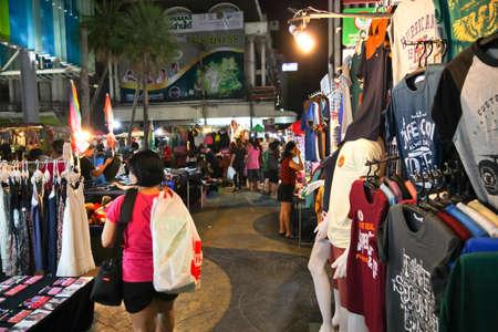night market: Chonburi, THAILAND - March 17, 2015:  Tourists stroll at the night market on MARCH 17, 2015 in Chonburi, Thailand. The famous night market in Chonburi,