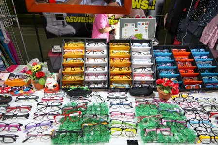 Chonburi, THAILAND - March 17, 2015:  eye glasses shop at the night market on MARCH 17, 2015 in Chonburi, Thailand.