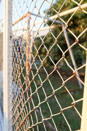 chained link fence: Steel net fence with blur background