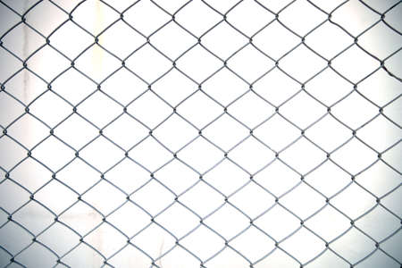 chained link: Steel net fence with blur background
