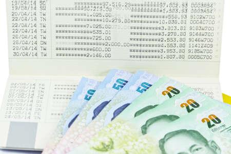 bank records: Saving Account Passbook with Thai money Stock Photo