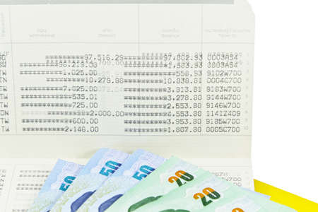 bank records: Saving Account Passbook with Thai money Stock Photo