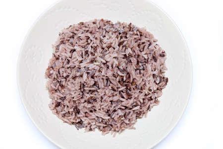 jasmine rice: Rice mix purple rice berry rice in white plate