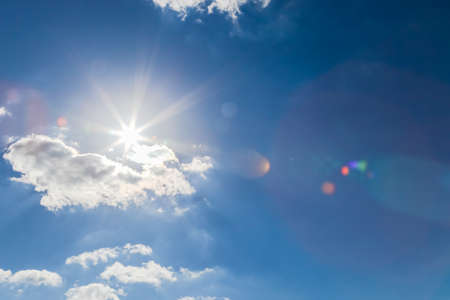 Cloud in blue sky and sun for background.