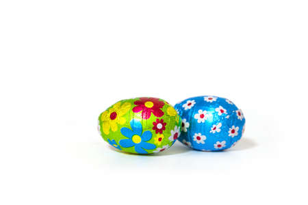 Easter Chocolate Eggs Wrapped with Colored Foil on white Background.