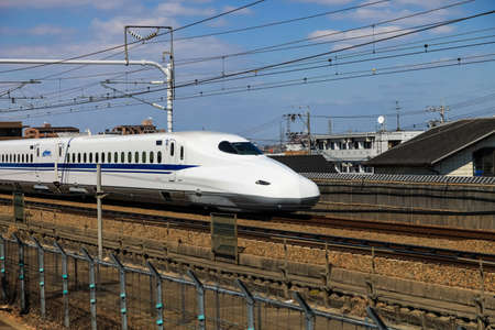 Nagoya, JAPAN - Mar 11, 2017 : A Shinkansen bullet train in Japan., Motion blur of a Shinkansen modern high speed train in Nagoya,Japan.
