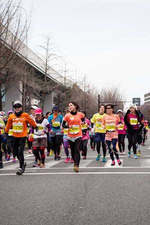 NAGOYA, JAPAN - MARCH 13, 2016: Nagoya Womens Marathon 2016.  Womens running in the downtown. in motion blur. Course Start and finish at Nagoya Dome Distance 42.195km. Nagoya city Japan. Editöryel