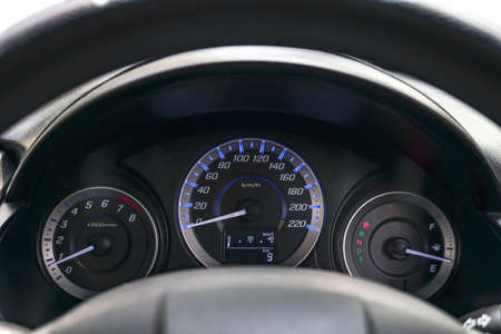 Speedometer and steering wheel,Mileage,Closeup dashboard of mileage car , Modern light car and New display of modern car.