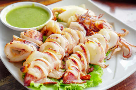 Thai Food,Slice of Grilled squid with Thai seafood sauce.