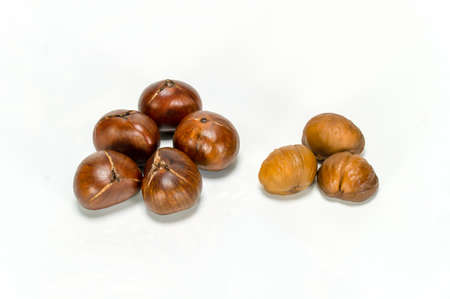 chestnut edible isolated on white background , roasted and peeled chestnuts isolated over white background