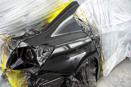 Car body after painting in a cars spray booth. Archivio Fotografico
