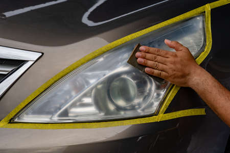 Closeup car lamp or front headlight polishing, renewed headlamp