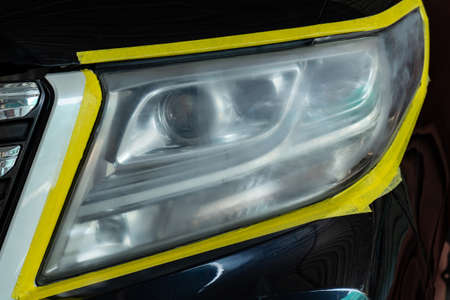 Polishing the optics of car headlamps ,Effect Before the effect of polishing Stock Photo