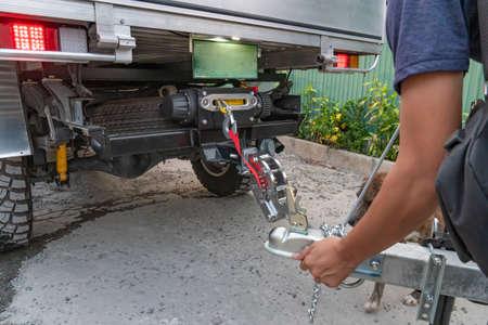 Technician is installing aluminum boat head,Aluminum plated boat trailer hitch isolated Reklamní fotografie