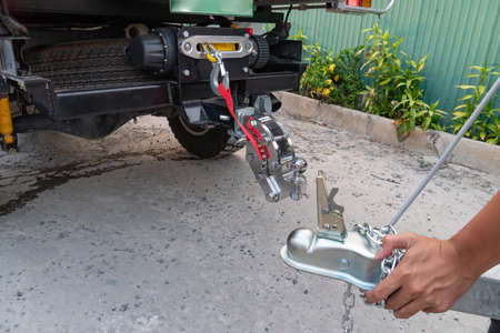 Technician is installing aluminum boat head,Aluminum plated boat trailer hitch isolated
