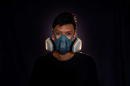 Men wear masks to prevent dust and smoke. ,black background